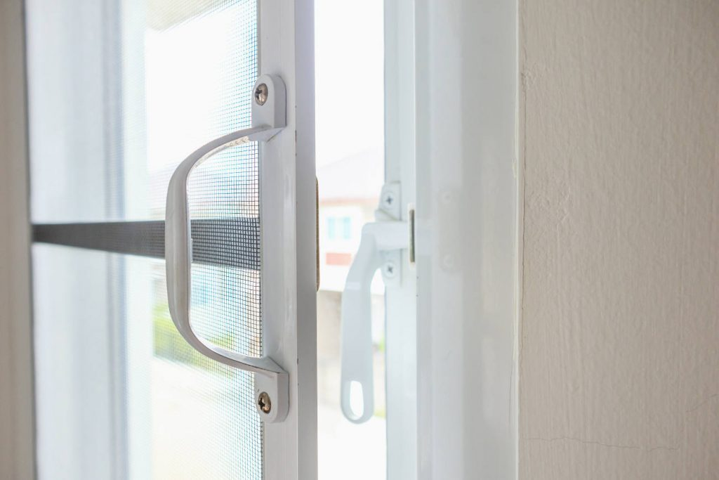 close up window screen handle